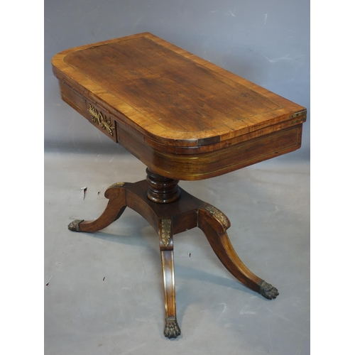 140 - A Regency rosewood card table, with brass inlay, raised on 4 sabre legs, H.70 W.92 D.90cm...