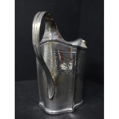 20 - A Georgian silver milk jug, with engraved floral decoration, indistinctly hallmarked, H.10.5cm, weig...