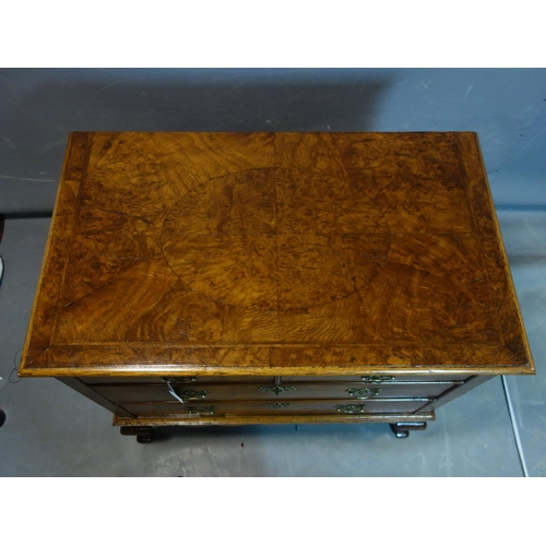 272 - An 18th and later burr walnut chest of two short over two long drawers, with quarter veneered top, r...