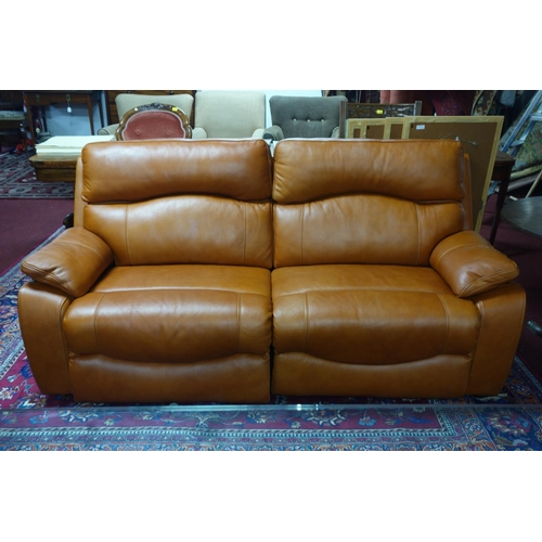 45 - A contemporary electronic reclining tan leather sofa...