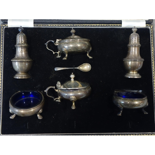 6 - A cased silver cruet set by Mappin & Webb, lacking 3 spoons...