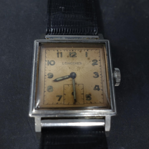 69 - A vintage Longines stainless steel gentleman's wristwatch, Arabic dial with subsidiary seconds dial ...