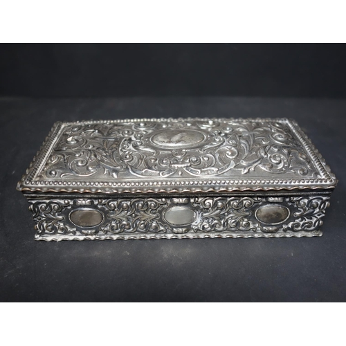 73 - A 19th century white metal box, repousse embossed with scrolling foliage, H.4 W.16 D.8cm...