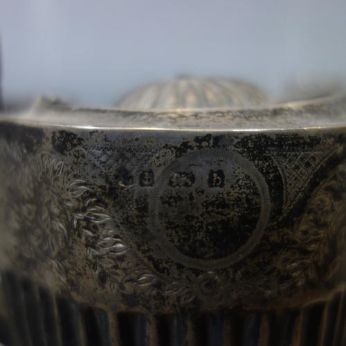 11 - A collection of silver to include a 3 piece tea set, 3 miniature trophies, a cup, and a box, 19oz...