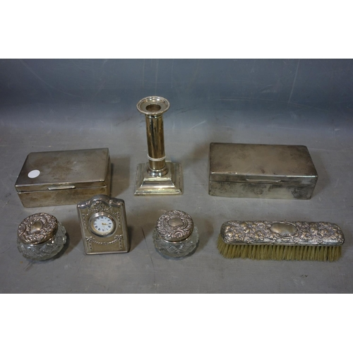 18 - A collection of silver items to include 2 boxes, a candlestick, clothes brush, clock and 2 glass jar...