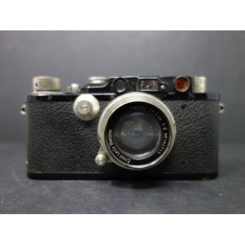 36 - A vintage Leica Ernst Leitz Wetzlar drp no 132212 camera, with original leather case fitted with a L...
