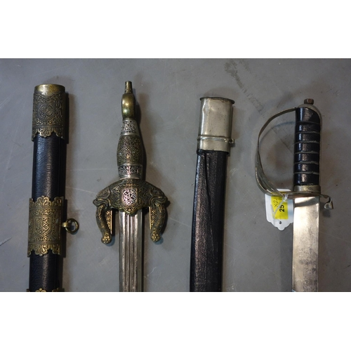 25 - An officers sword, H.93cm, together with a Middle Eastern style decorative sword, H.90cm...