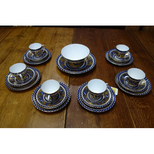 30 - A set of six 19th century Coalport blue and gold porcelain tea cups and saucers, decorated with bird...