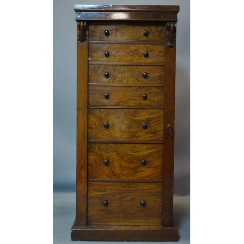 174 - A 19th century mahogany and walnut wellington chest of 7 drawers, with key, H.127 W.56 D.40cm...