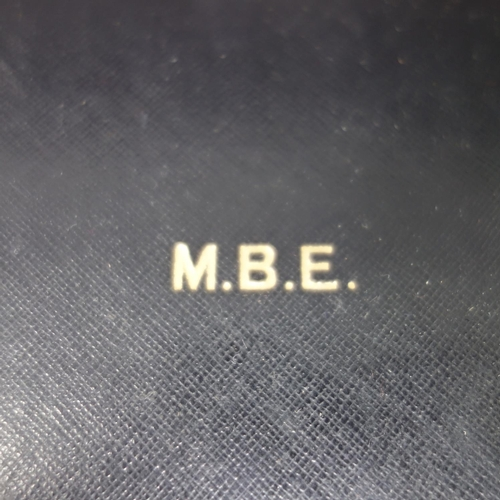 38 - A mid 20th century M.B.E medal, in original case, with certificate and a signed letter from Buckingh...