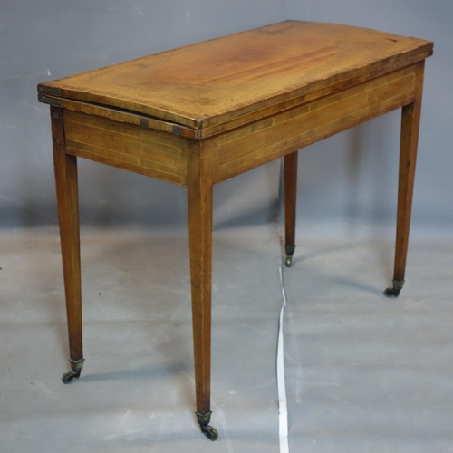 1 - A Georgian inlaid mahogany card table, raised on tapered legs and castors, H.72 W.91 D.44cm...