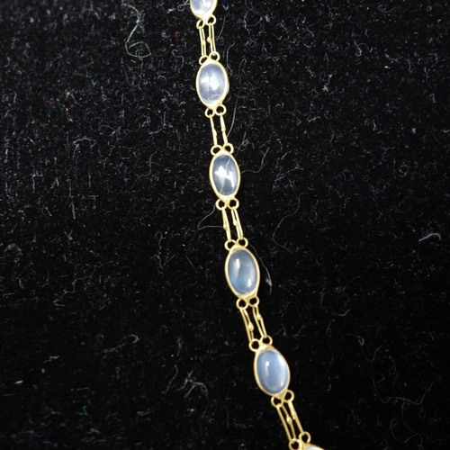 7 - A 14ct gold necklace set with moonstones...