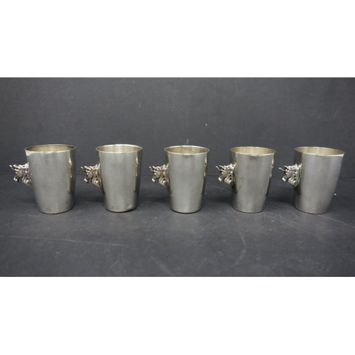 29 - A set of five Sterling silver unicorn shot glasses by Garrard (the Royal Jewellers for the HRM), hav...