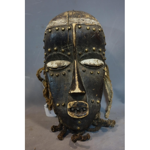 2 - A West African tribal mask from the Dan / Bete peoples of Ivory Coast / Liberia, wooden with brass s...