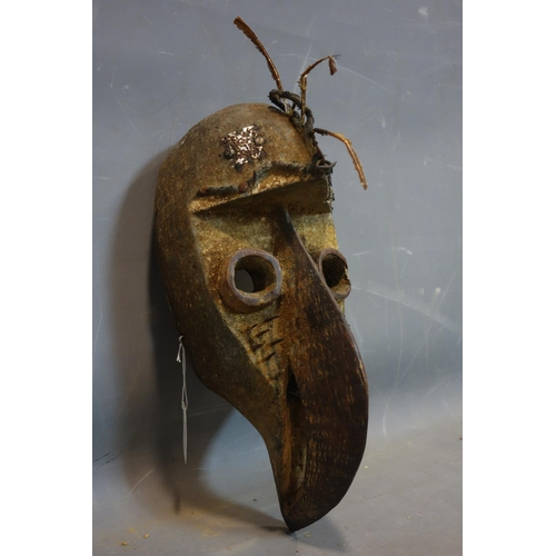 13 - A West African tribal carved bird mask by the Grebo people, Sierra Leone, with quills, plaque and sp...