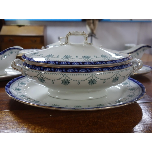 44 - An early 20th century Royal Doulton dinner service, comprising 1 large tureen, 1 smaller tureen, 2 g...