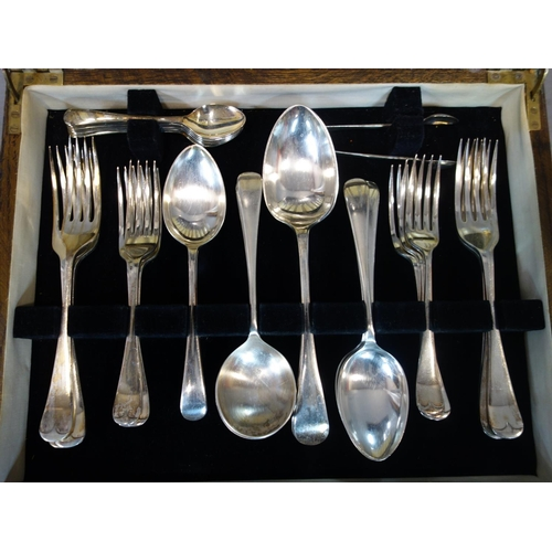 32 - An oak canteen of silver plated cutlery, to include knives, forks, spoons, serving spoons, teaspoons...