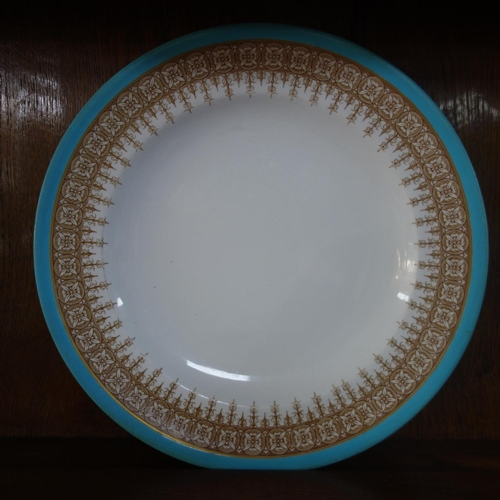 34 - A Royal Worcester part dinner service, with turquoise rim and gilt floral border, marked to bases, c...