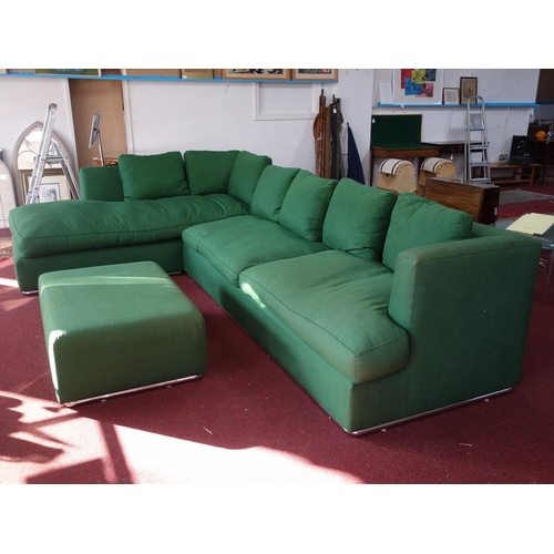 11 - A large green upholstered L shaped sofa, with matching ottoman, 'At Crorin Workshop' label to verso,...