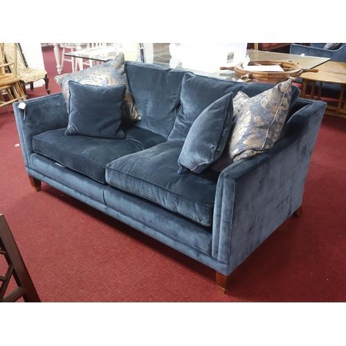 43 - A Duresta 'Collingwood' sofa with blue velvet upholstery, raised on tapered legs...