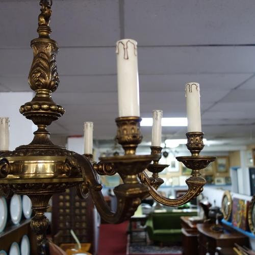 139 - An eight branch gilt metal chandelier, H.54cm Diameter 69cm...