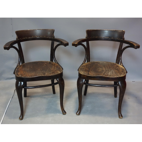180 - A pair of antique Thonet bent wood armchairs, both with paper label...