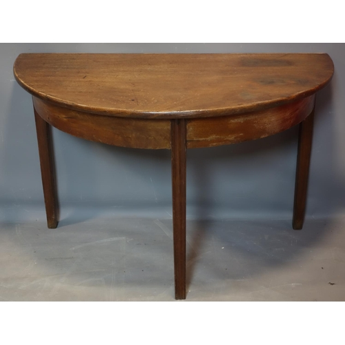 197 - A pair of 19th century mahogany demi-lune tables on tapering legs, H.70 W.113 D.60cm...