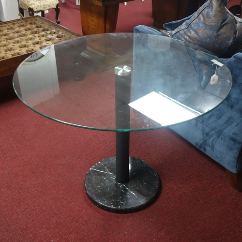 239 - A contemporary circular dining table with glass top raised on marble base, Diameter 99cm...
