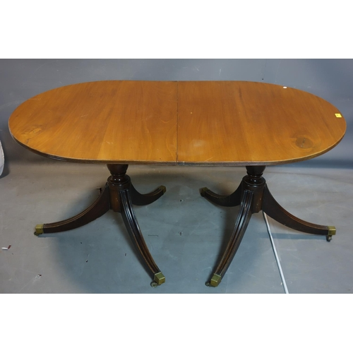 252 - A 19th century mahogany D-end dining table, raised on twin pillar supports and splayed legs, H.160 W...
