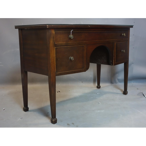 351 - A Regency/Edwardian bow fronted inlaid mahogany writing table with one long drawer, two deep drawers...