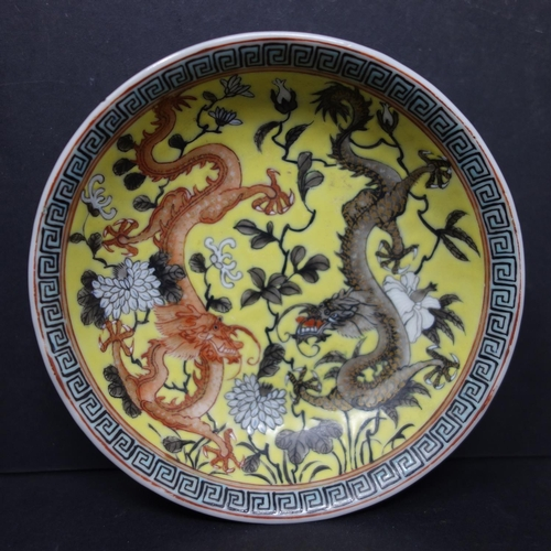 423 - A Chinese Republic period dish, decorated with dragons and flowers in grisaille and red on a yellow ...