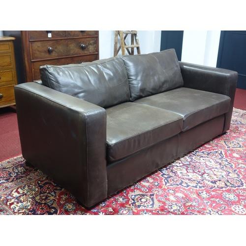 19 - A contemporary leather sofa...