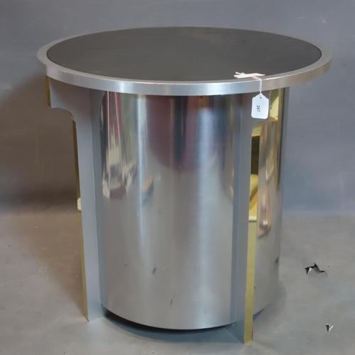 267 - A Postmodern brushed aluminium table with circular glass top, H.73cm Diameter 76cm...