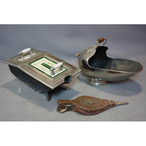 280 - A Victorian cast iron coal scuttle, set with tiles, together with one other and a pair of bellows...