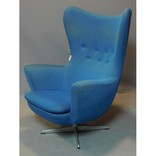 216 - An Arne Jacobson Swan style armchair with blue upholstery, H.112 W.84 D.75cm...