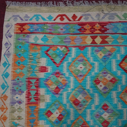 331 - An Afghan vegetable dyed kelim, with repeating diamond medallions on a turquoise ground within geome...