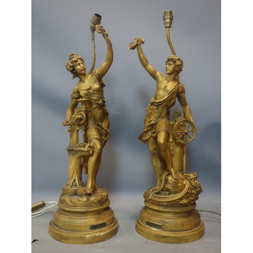 142 - A pair of early 20th century French gilt spelter figural table lamps, 'Commerce' and 'Industrie', H....