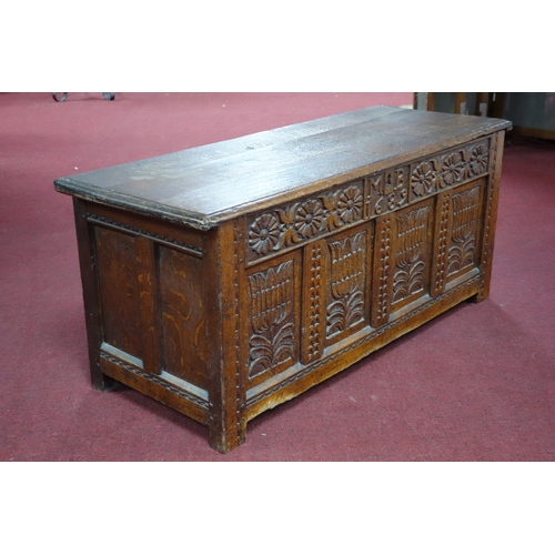 199 - A 17th century oak coffer of panelled construction, with fitted candle box, the front carved with fl...