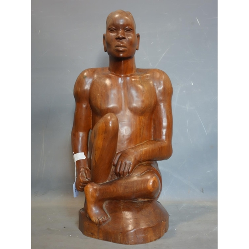 28 - An African hardwood carving of a man, H.77cm...
