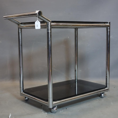 134 - A vintage chrome 2 tier drinks trolley, with smokey glass shelves, raised on castors, H.75 W.80 D.46...