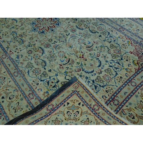 280 - A Persian Isfahan Nain carpet, floral motifs on a cream ground within floral border, 320 x 202cm...