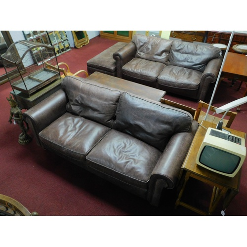76 - Two Fishpools leather sofas together with matching foot stool...