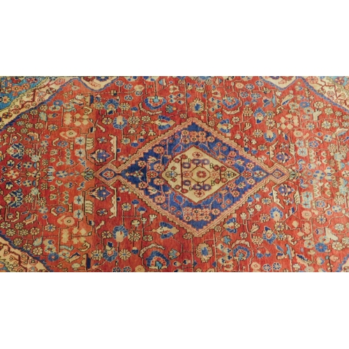 185 - A north west Persian Sarouk rug, the central double pendant medallion with repeating petal motifs, o...