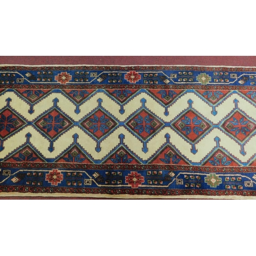 186 - A north west Persian Ardebil runner, with repeating stylised diamond motifs, on an ivory ground, con...
