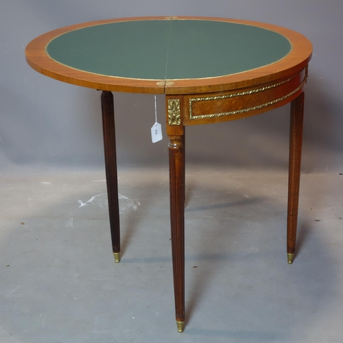 275 - An Empire style inlaid mahogany demi lune card table, on reeded legs with brass caps, 81 x 90cm...