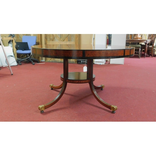 296 - A mid 20th century Regency style walnut and part ebonized centre table, raised on 4 reeded splayed l...