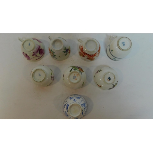 167 - A miscellaneous collection of 19th century continental porcelain cups. (8)...