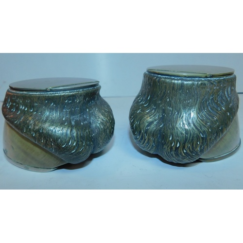 169 - A pair of 19th century silver plated horse hoof inkwells. H.9 W.16cm...