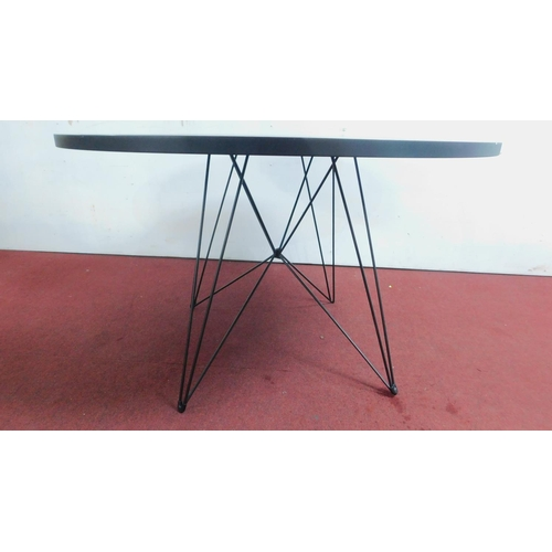206 - A contemporary designer circular table, lacquered top on hairpin supports. H.75 W.120cm...