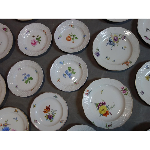 297 - A collection of Meissen porcelain to include 23 plates, a cup and a sugar pot...